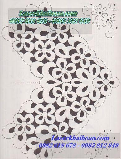 cắt hoa văn trên vải làm khăn trải bàn