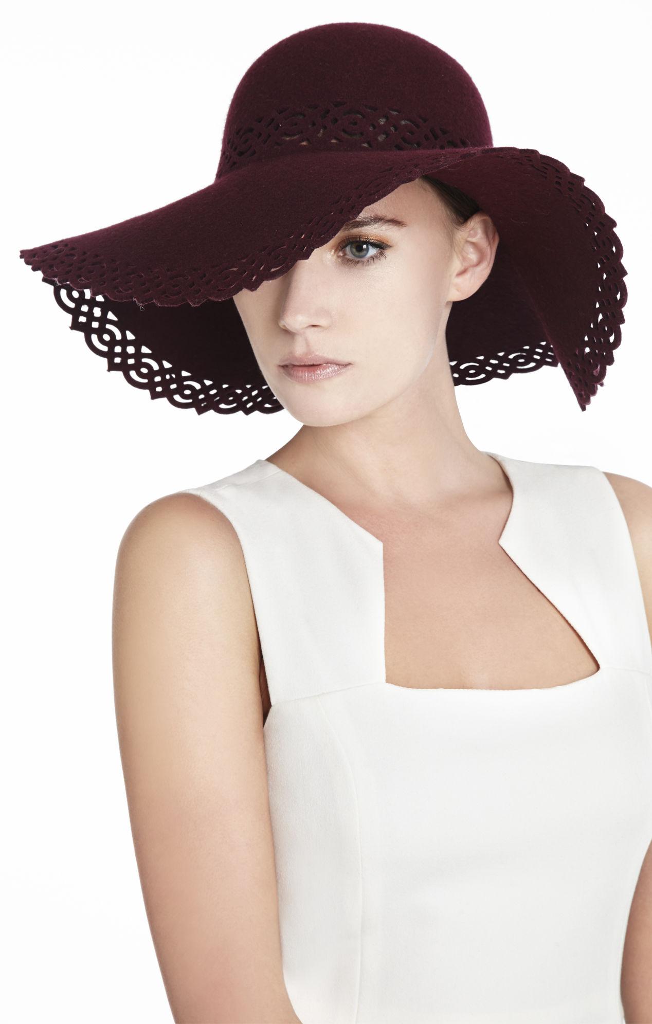 Đục lỗ trên vải may nón giá rẻ